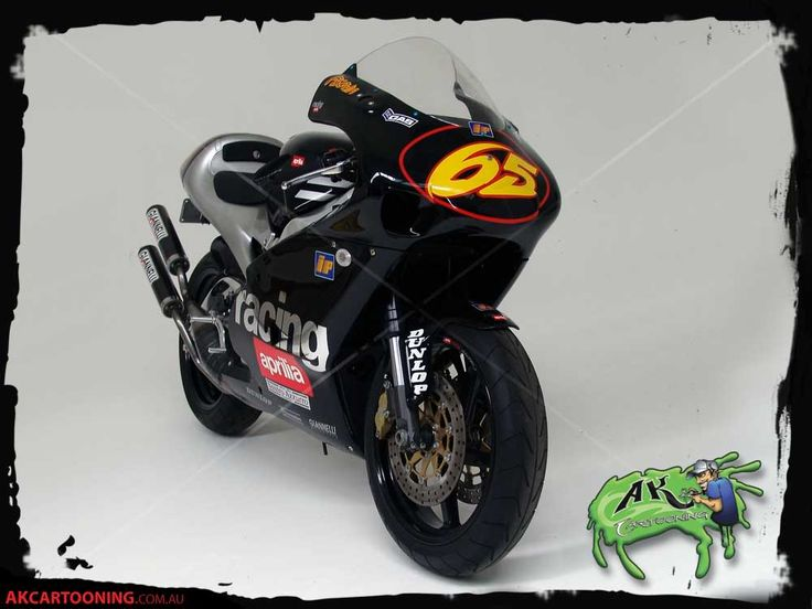 A replica of Loris Capirossi's Aprilia 250,  This job was all decals, All logo's mocked up in Illustrator as a vector format and vinyl cut on my GX-24 Roland.