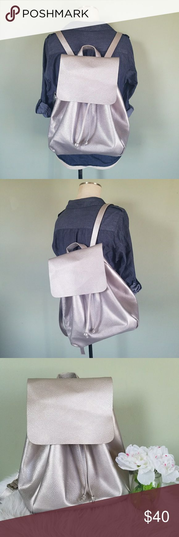 "Zara TRF Silver Backpack Zara Trafaluc. Foldover Flap Backpack Color: Silver. Drawstring closure. Foldover flap top. Adjustable straps. Large size. 16"" x 12"" x 8"" Great condition. Inside has some staining but has been cleaned. Zara Bags Backpacks"
