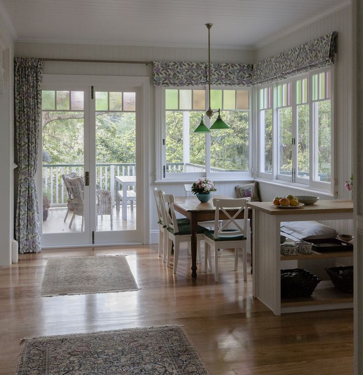 Sliding windows and French Doors with a traditional look by Against the Grain Windows & Doors - gorgeous country living!