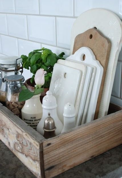 Display those utensils you use regularly in a wooden tray on your worktop - it looks great and it's very practical!