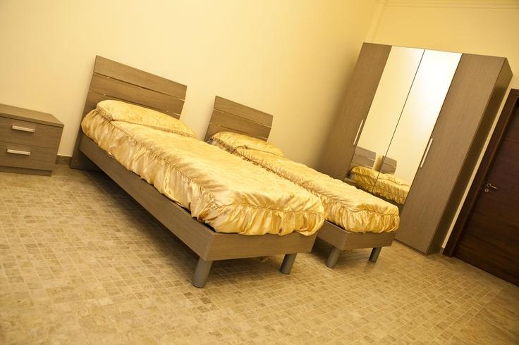 Bilocale con due camere da letto e bagno privato
