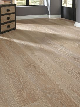 Weathered Windmill, from the Casual Collection, featuring prefinished wood flooring with eye catching grain lines, and smooth creamy hues that blend with warm, nutty undertones.