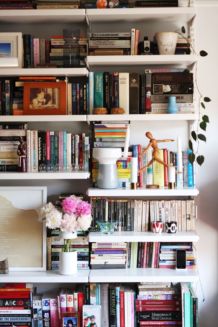 Here is a beautiful example on how real people style their bookshelves.