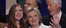 Democratic presidential nominee Hillary Clinton stands with her daughter Chelsea (L), vice presidential running mate Senator Tim Kaine (C, rear) and her husband former President Bill Clinton after accepting the nomination on the final day of the Democratic National Convention in Philadelphia, Pennsylvania, U.S. July 28, 2016. REUTERS/Mike Segar