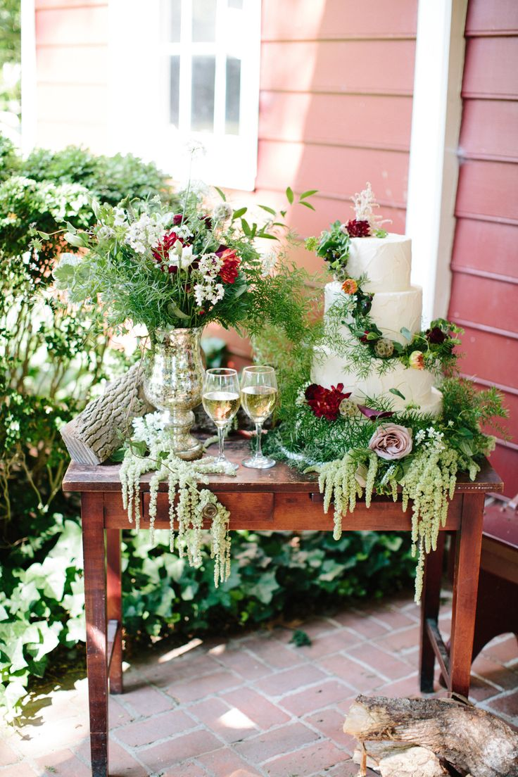 A woodlands oasis calls for brilliant blooms and a lush green tablescape.  Photo…