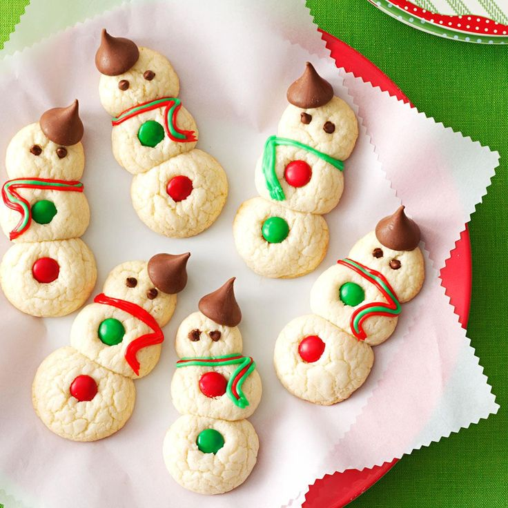 Snowman Cookies Recipe -Wrap these chocolate-topped snowmen in colored tissue and place them inside holiday containers. Like real snowmen, they disappear fast! —Betty Tabb, Mifflintown, Pennsylvania