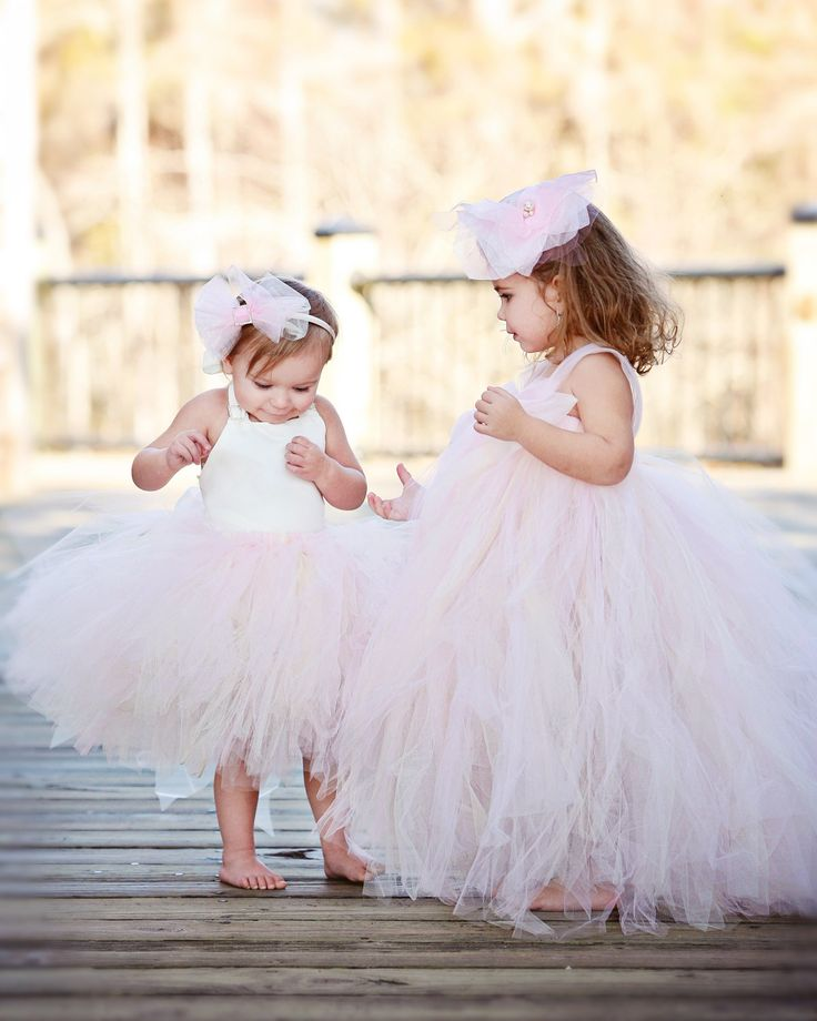 On the left. Blush Flower Girl Tutu Dress--Organza Bow--Available in Many Color Combinations----Perfect for WEDDINGS. $97.00, via Etsy.