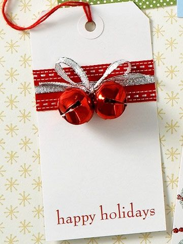 tag wrapped with ribbon, tied with pair of bells, sentiment stamped on bottom. too cute!