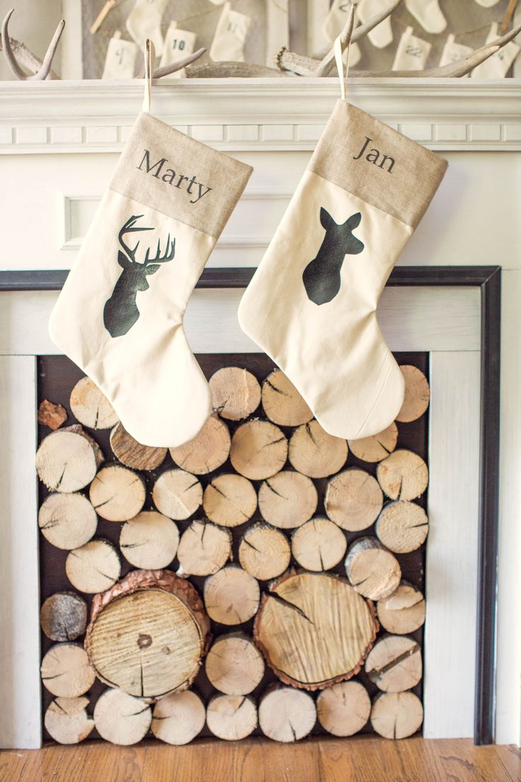 Rustic deer silhouette neutral christmas stockings with antler stocking holders