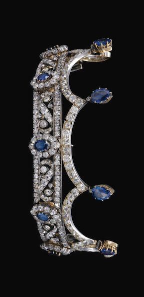 SAPPHIRE AND DIAMOND TIARA, LATE 19TH CENTURY Designed as a series of pinnacles each surmounted by a pear-shaped sapphire, the base of scroll design interspersed with oval sapphire and diamond clusters, set throughout with cushion-shaped, circular- and single-cut diamonds, inner circumference approximately 220mm, top tier detachable.