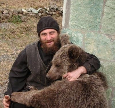 Orthodox Monk just hugging a bear.... wow