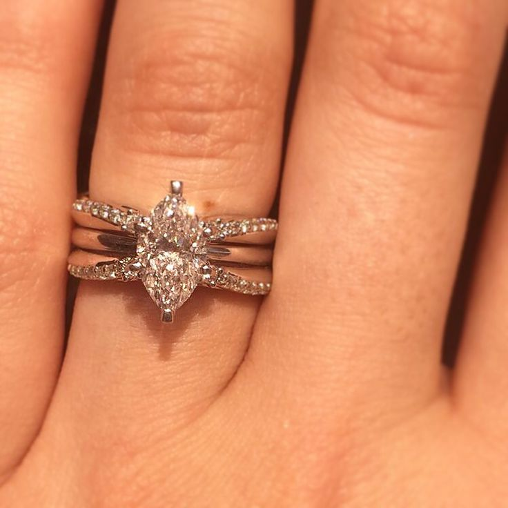 Absolutely stunning 1.5 carat marquise solitaire engagement ring in a beautiful enhancer.
