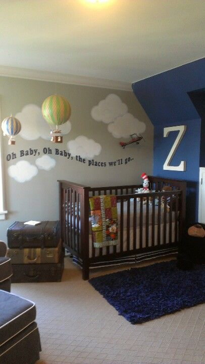 """Custom Nursery decor by The Iron Gate Cottage. Travel theme with Dr. Suess quotes. Hand painted cloud mural above baby's crib...""""Oh baby, Oh baby, the places we'll go..."""""""