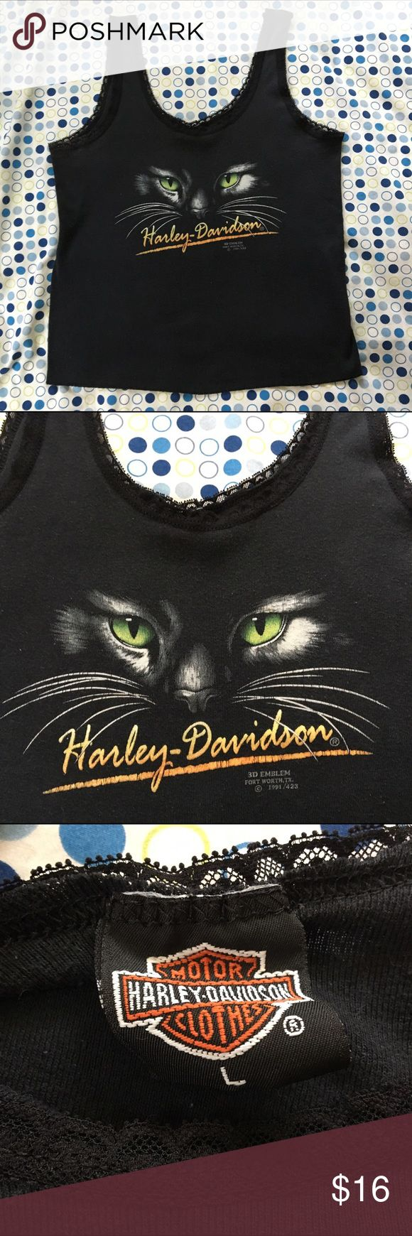 Vintage Harley Davidson Cat Tank Top This vintage Harley Davidson black cat tank top is in very good condition. No holes or stains but does have some slight pilling. Below the cat face in small print is says 3D emblem Fort Worth, Texas 1991. Beautiful lace border. Runs a little small. Harley-Davidson Tops Tank Tops