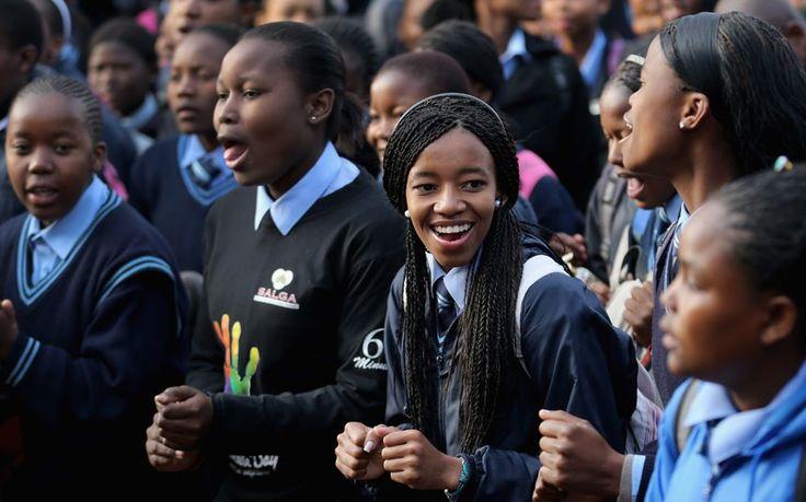 Schoolchildren sing 'Happy Birthday'  at Phefeni High School, opposite Mandela's former home in Soweto Township in Johannesburg