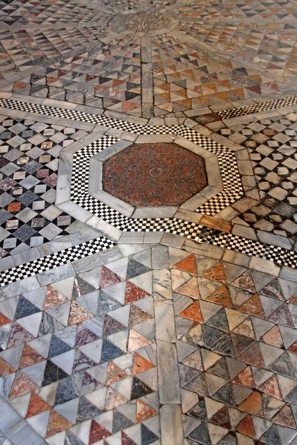 The floor in St. Mark's Basilica in Venice, Italy is composed of ornate patterns of marble tiles - some of which date back to the 12th Century.  AIMG_4769