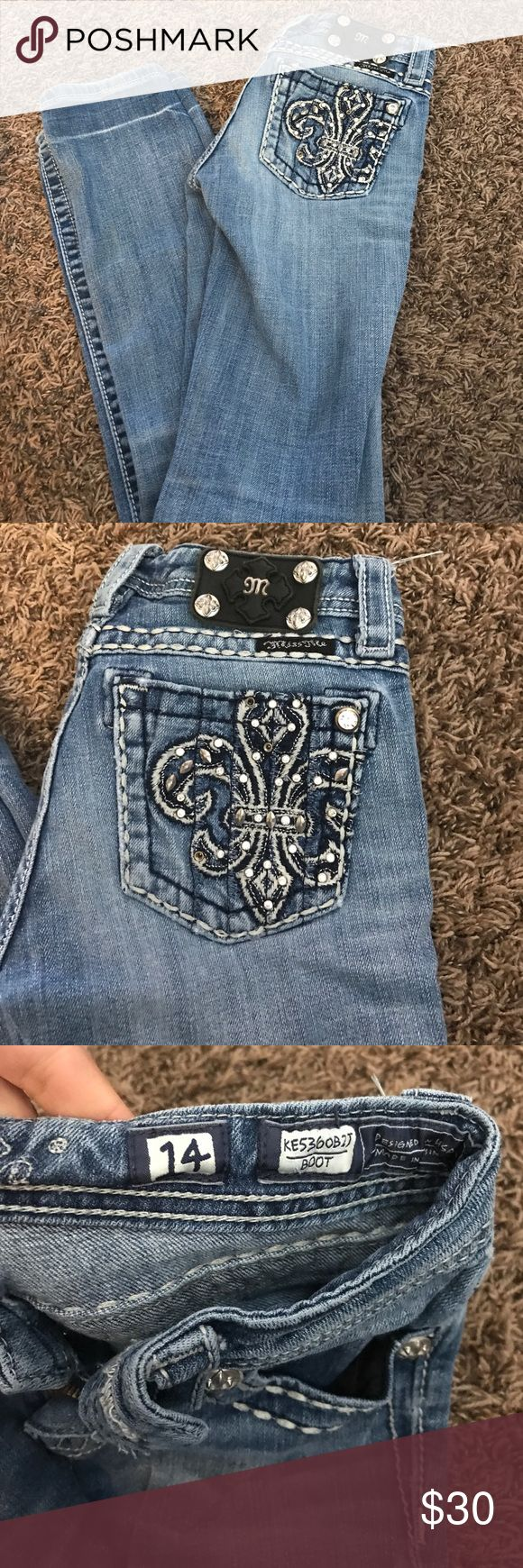 Girls size 14 miss me jean Girls size 14 miss me jean these we originally boot cut but were altered into more of a straight leg also button fell off so we put one on I'm sure if you went to your local buckle store they give you a button for them we just never got around to it and the button we put worked fine Miss Me Bottoms Jeans
