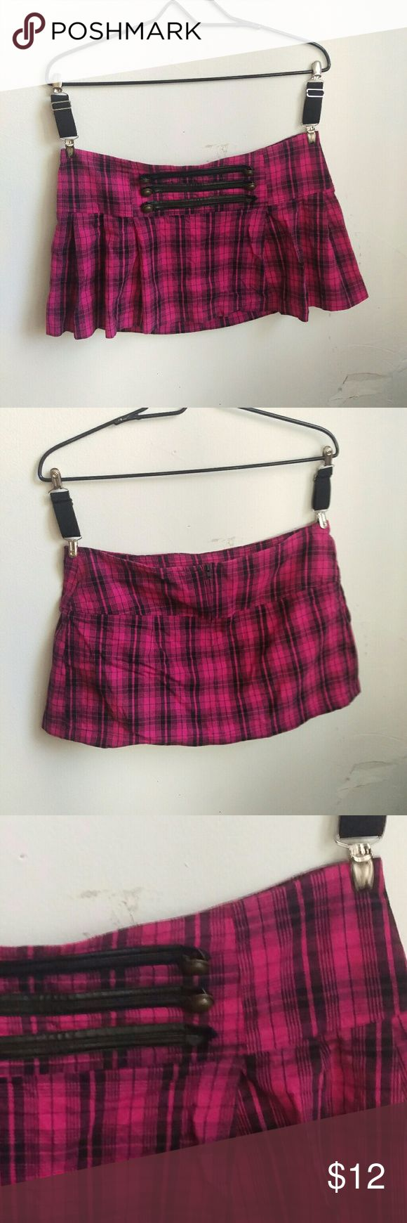 Plaid pleated mini skirt Pink plaid schoolgirl-style pleated miniskirt. One of the (non-functional) buttons on the front is missing (pictured) There's no size tag so I'm just guessing, feel free to comment for measurements  **10% off bundles! All offers considered** Punk emo goth gothic rave raver scene retro pinup vintage school girl tartan uniform 90s rockabilly tartan clueless girly alt alternative Sweet Love Skirts Mini
