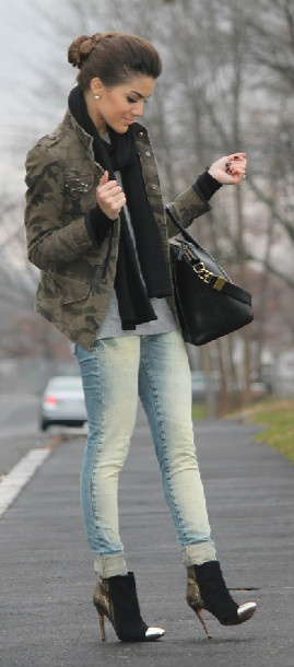 faded jeans. cropped military-styled jacket. gold tipped stilettos (jeans and t-shirt)