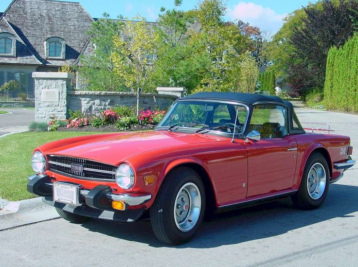 1976 Triumph TR6 with the top up. So little and adorable :)