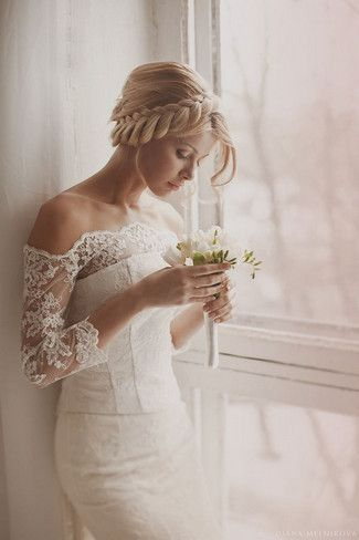 A stunning bridal upstyle with a braided crown and flowing tendrils. EVERYTHING ABOUT THIS IS PERFECT