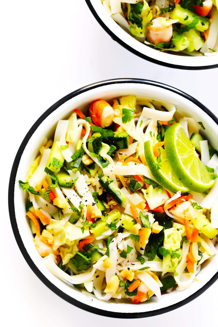LOVE this Vietnamese Spring Roll Salad! It's full of rice noodles, cucumber, carrots, cabbage, sprouts, peanuts, lime, mint, and a zesty vinaigrette. Such a fun pasta salad!   Gimme Some Oven #pastasalad #vietnamese #noodles #springrolls #glutenfree