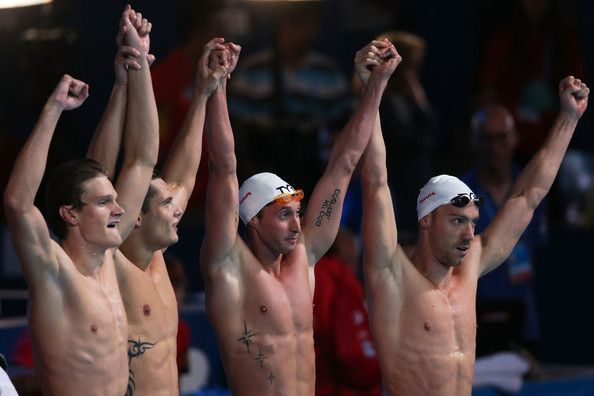 Yannick Agnel, Florent Manaudou Fabien Gilot and Jeremy Stravius of France celebrate after the Swimming Men's 4x100m Freestyle on day nine of the 15th FINA World Championships at Palau Sant Jordi on July 28, 2013 in Barcelona, Spain.