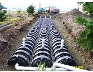 The following are some pictures of various conventional gravity systems  with washed drain rock & piping: