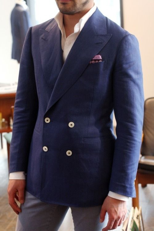 Shop this look on Lookastic: https://lookastic.com/men/looks/navy-double-breasted-blazer-white-dress-shirt-grey-jeans-pink-pocket-square/439 — Navy Double Breasted Blazer — Pink Pocket Square — White Dress Shirt — Grey Jeans