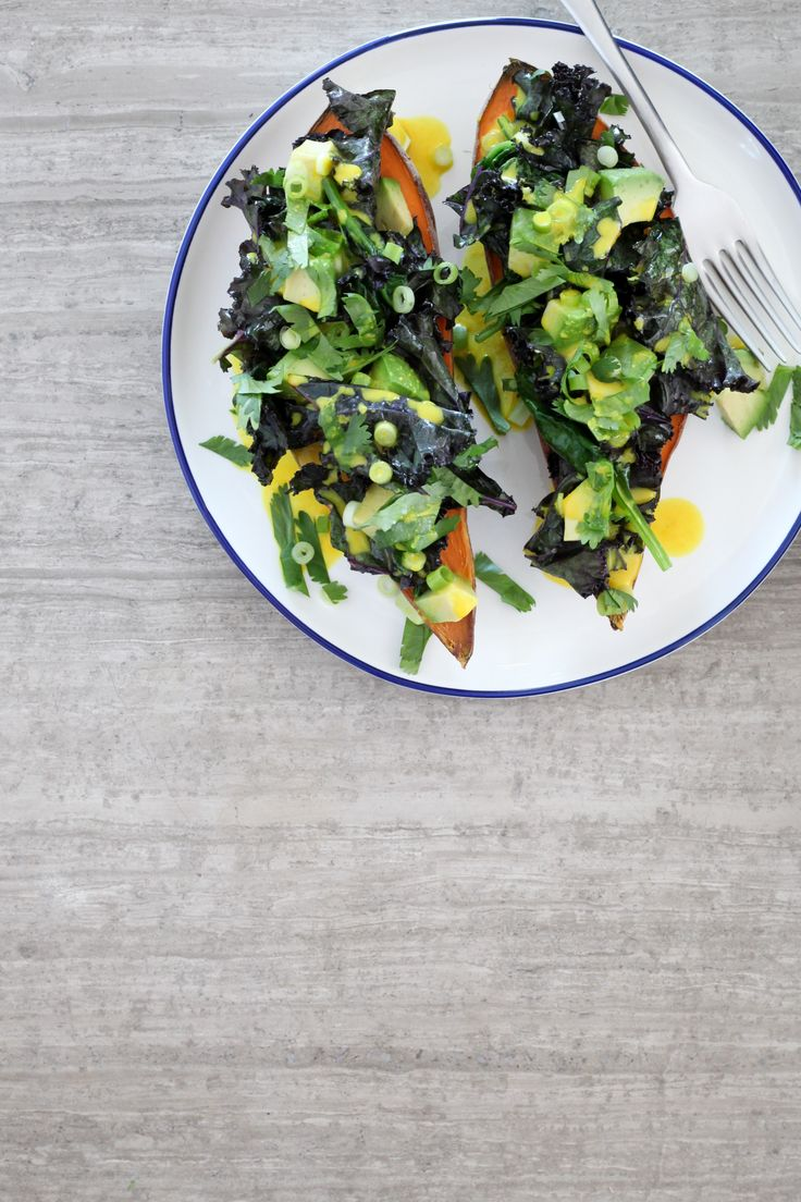 Baked Sweet Potato With Spinach, Kale, and Avocado with Turmeric-Tahini Dressing | amodestfeast.com | @amodestfeast