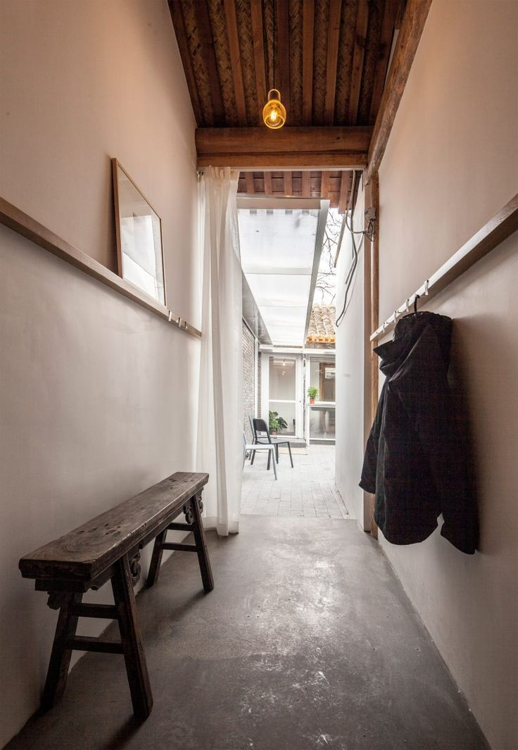 Measuring just 32 square metres, the residence is surrounded by five similarly petite properties that encircle an outdoor courtyard
