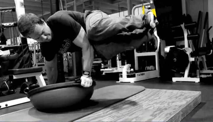 Mark Wahlberg training his core with a TRX. Oooh I like this!!!  Must try!