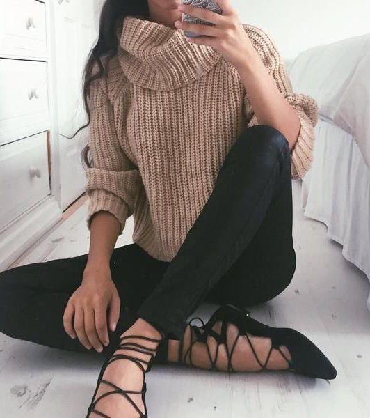 a camel turtleneck knit, black lace up flats and black leggings