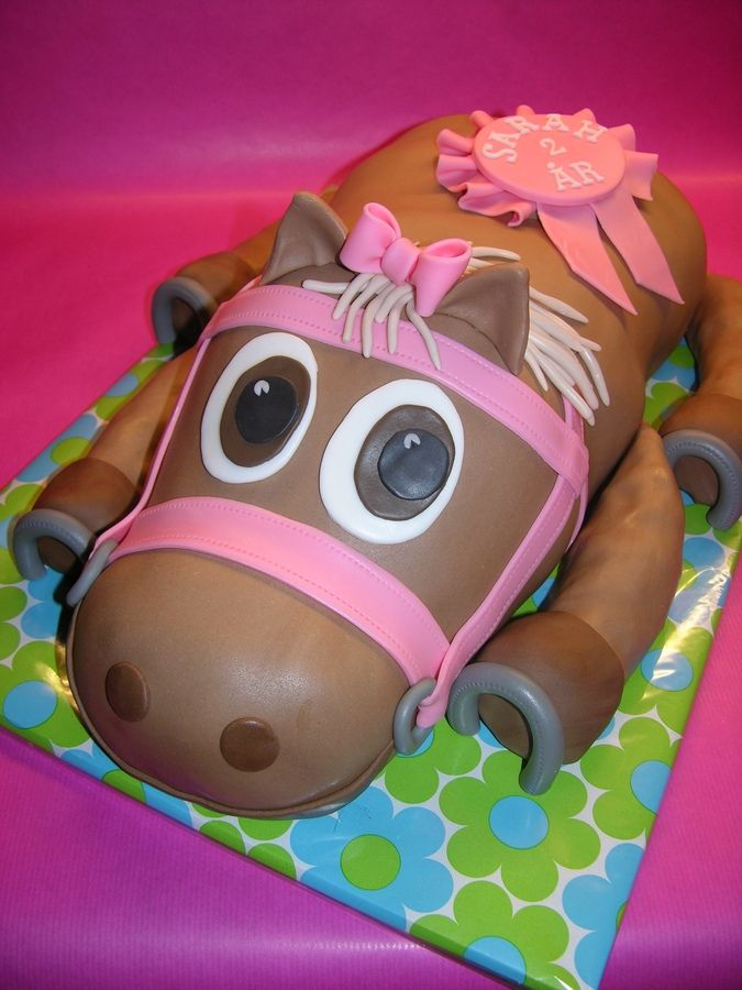 A huge horse cake for a little girl who turned 2 years old. Chocolate cake with chocolate cream cheese frosting.