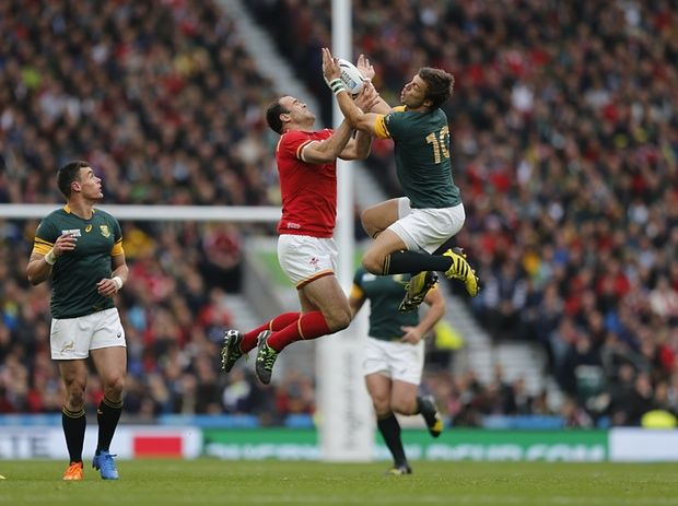 Jamie Roberts jumps for the ball with South Africa's Handre Pollard.