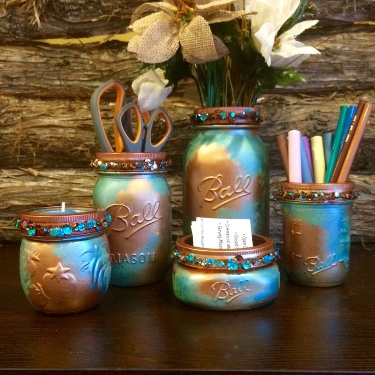 Office Mason Jar Set or Mason Jar Bathroom Accessory Set in a Copper Patina finish. Office, Bathroom or Vanity mason jar set in beautiful bright metallic copper with turquoise and green patina. Each jar has a copper toned lid ring that is embellished with beautiful turquoise and cooper toned sequins. This set of 5 jars. Includes a flower vase, 1 pen & pencil holders or toothbrush holder, 1 accessory or hand sanitizer jar, a business card or q-tip holder, and a beautiful tea candle jar or ...