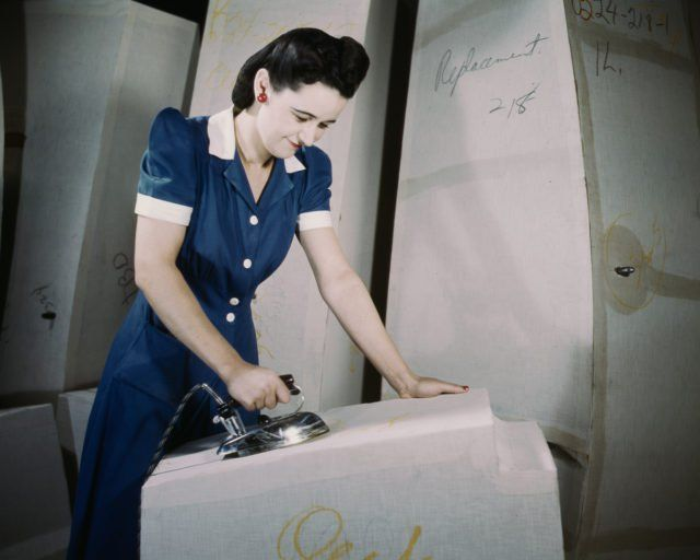 A worker irons at a factory for self-sealing gas tanks owned by the Goodyear Tire and Rubber Co. in Akron, Ohio.