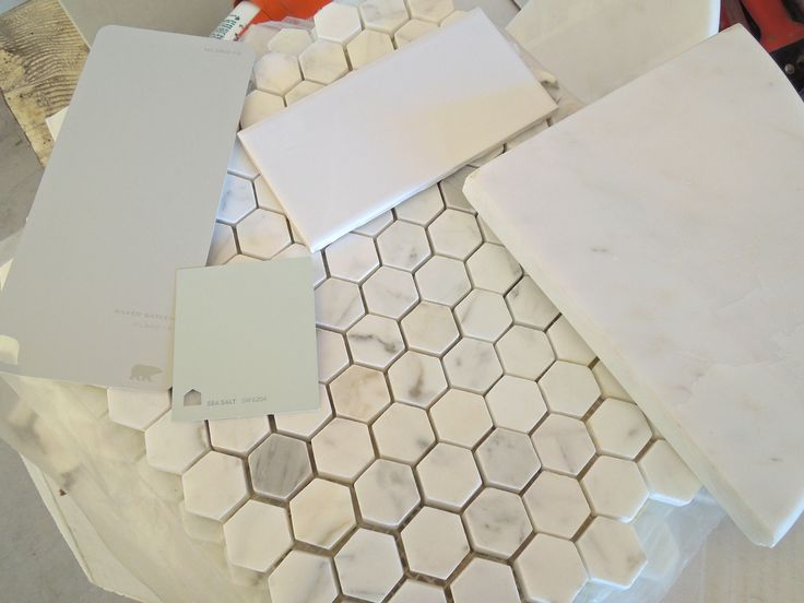 grey subway tile shower | Honeycomb marble floors, subway tile shower, grey cabinets, mint walls ...