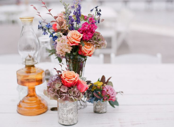 Colorful Floral Centerpieces with Vintage Oil Lamp