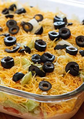 Save this Taco Dip recipe for football Sundays and make all of your guests happy! | skinnytaste.com