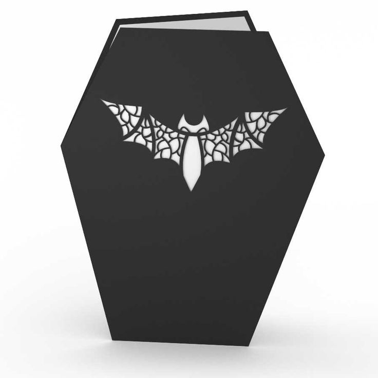 The cover of this one of a kind coffin shaped pop up card features an intricate bat design. Once opened the card features a handsome vampire showing off his elegant outfit