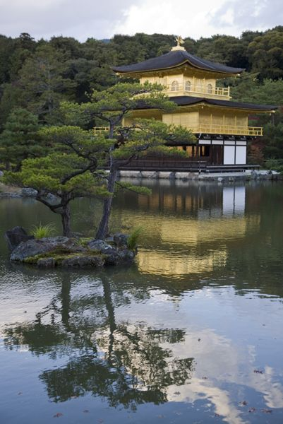 Kinkakuji in Kyoto Japan.  Kinkaku-ji translates to Temple of the Golden Pavilion.  It is a Zen Buddhist temple set in classically designed Japanese gardens.
