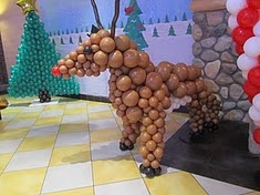 Creative Balloon Decor Ideas for your next Holiday gathering. This Rudolph & Tree Sculpture provided by Westfield Plaza Bonita for Santa's Incredible Pizza Pajama Party at John's Incredible Pizza Co.