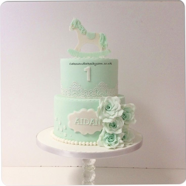 Mint green rocking horse and fondant sugar flower birthday cake