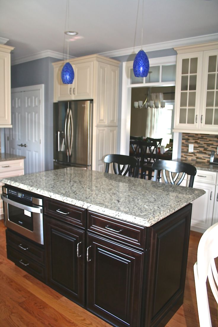 Beautiful island with built in stove waypoint cabinetry for Beautiful built in kitchens