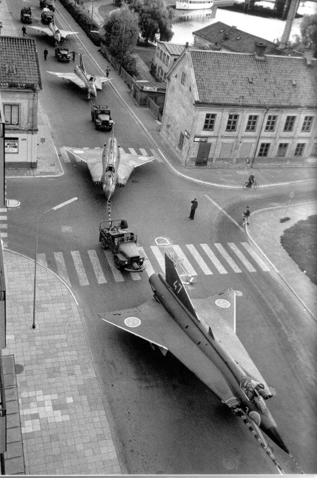 Transport of seventeen J35D in Linköping where the SAAB headquarters is based. The year was 1966. (x/post from r/Sweden) [640x960] —- Military Shop: http://j.mp/military-store