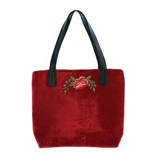 This Tamsin Cooper tote bag comes in sumptuous silk velvet. It's is both roomy and practical and has a luxurious satin lining, internal pockets, a zip closure and soft leather handles.