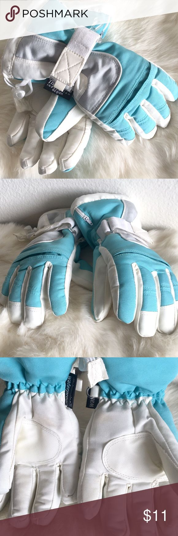Youth Winter Gloves Waterproof winter/snow gloves. Aqua and cream color. Few faint spots on the palms side. Other than that, great condition, barely worn. Tag reads Youth size 4-7. Thinsulate Accessories Mittens