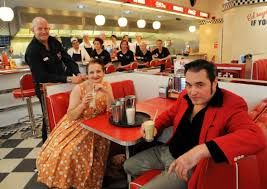 Karen James Welton and Simon Pritchard in 1950s dress for the opening of Ed's Easy Diner at Intu Chapelfield Food Court, with general manager Justin Beeslee, and some of the staff.