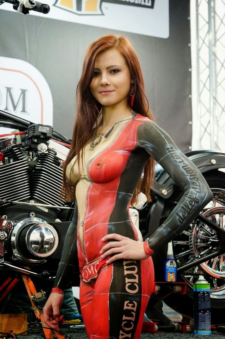 Petite naked girl on motorcycle